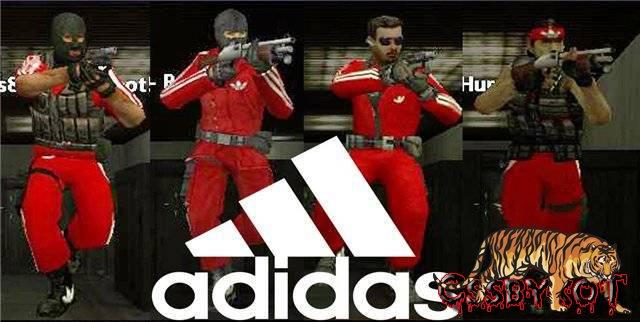Красный спортивный костюм Adidas.